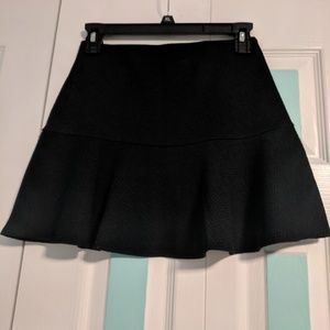 Bethany Mota black mini skirt